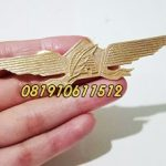 pin cor wings kuningan